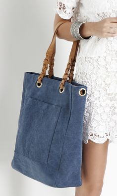 Canvas tote bag with braided straps and back & front pockets (great for your phone!)