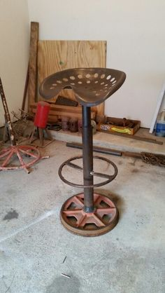 Vintage tractor seat stool with 360°swivel, gear base and valve handle step. Info@designerpipe.com
