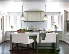 gray green kitchen design with barrel range hood sith iron forged straps, gray green kitchen island with marble counter tops