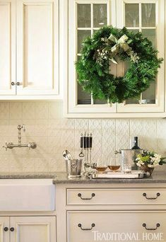 Spice up (literally!) a green wreath with the use of cedar, spruce and pine branches, and evergreen berries. - Traditional Home® / Photo: Eric Roth / Design: Tanya Capello