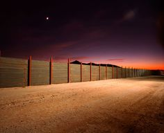 "The Border during night time:   ""A wall along the U.S.-Mexico border prompts divided feelings: it offends people. It comforts people. And it keeps expanding."""