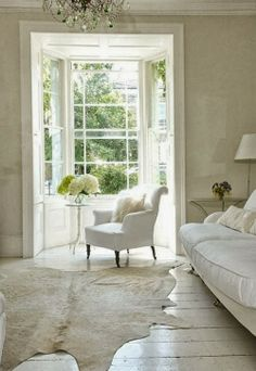 invite the sun in today   danacaseydesign   white couch and chair in a sunny living room