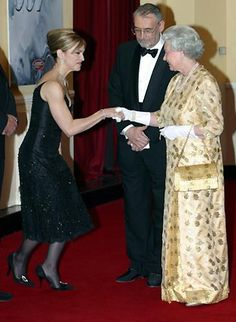 Madonna curtsies as she meets the Queen at the world premiere for 2002 Bond film, 'Die Another Day'.