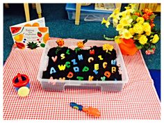 Preschool Garden Theme Literacy Lesson: Sing ABC song, children take turns using shovel to dig up an alphabet letter, read story 'Eating the Alphabet' by Lois Ehlert, children take turns telling what their favorite food from the alphabet is.