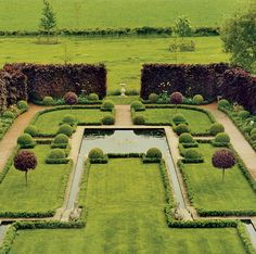 Copper-beech hedges surround bay trees, box balls, and a koi pool in the Engagement Garden. Stella McCartney's home.