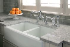 Quartzite This is an amazing material. It is naturally strong, resists heat and is hard to stain. Quartzite is formed from sandstone and quartz together under a great deal of heat and pressure. The empty grains of sandstone are filled with quartz.