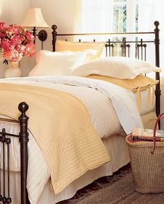 I love metal beds in a guest room. Very bed and breakfast.