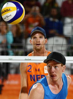 Germany's Markus Bockermann eyes the ball during the men's beach volleyball qualifying match between the Netherlands…