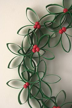 Christmas wreath. Leaves made from painted toilet paper rolls, cut and glued together...