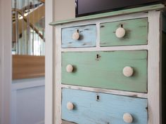 Green and blue distressed chest of drawers  From Blog Cabin HGTV