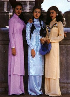 """10-11-11  Vietnamese national women's dress includes a long, high-necked silk tunic that is slit at the sides to the waist. Here the solid-color, pastel tunics are worn over matching full-length skirts, common to northern Vietnam, but they also are worn over white or black silk pants in the central and southern regions. The costume is called áo dài (pronounced """"ow zai"""").    This costume actually was created in the 1920s, during the period of French rule, when Vietnamese nationalists…"""