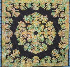 Multicolored Hawaiian quilt pattern - I like the idea of the multicolored applique on the dark background