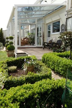 White conservatory verandah with a lovely green garden and gorgeous #sunroom