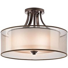 White etched glass and a translucent organza shade combine in this Mission bronze finish ceiling light that features a chic double shade.
