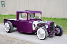 Looking like a vintage kit model come to life, the classic hauler exudes plenty of '60s-era vibe. A custom kicked & Z'd frame features a traditional dropped tube axle with hairpins while a Ford 9-inch rear pushes power from a highly detailed 235ci Chevy six-cylinder mill. Plenty of PPG purple completes the feel accented by wide whites and Moon discs.