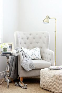Layer the lighting in your room to create a cozy home. This reading corner gets a floor lamp of its own to create an inviting space.