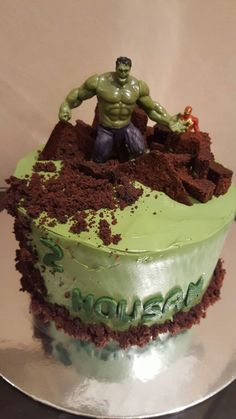 Easy Hulk Cake Green buttercream icing with crushed cookies around