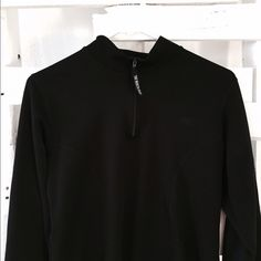 The North face half zipper Long sleeve north face shirt. Minor piling on bottom right sleeve, easily fixable. Half zipper. Good quality. The brand name peeled off the front. Size : large (womens) color: black. I will be sewing the minor flaw soon to prevent further piling. 3rd pic is measurement from shoulder to bottom. 4th pic is the mid area width. North Face Tops