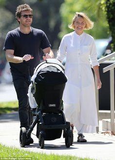 Family fun: Sam Worthington and Lara Bingle took their littler bundle of joy, Rocket Zot, . Lara Worthington, Network Ten, Days Of Our Lives, Australian Fashion, Advertising Campaign, Fashion Models, Baby Strollers, Sons, Walking