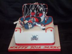 Cake for an Ice hockey Goalie. Modelled on the actual kit he wears while playing :)
