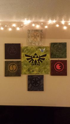 My wife worked on some Zelda themed paintings for me over the holidays. Finally hung them up today. (xpost from /r/Zelda)