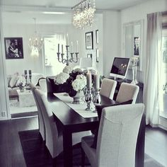 dining room beige chairs dark wood table Z Gallerie modern chandelier