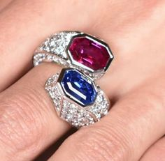 Mingling among over 100 #diamonds on this Toi et Moi #ring, two #emeraldcut #unheated gemstones: a 2.55 carat #Burmese #ruby, together with a 5.22 #carat #Ceylon #sapphire ❤ #worldofreza