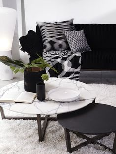 Fineline coffee tables by SPENCE & LYDA with the Salamanca cushion and throw by MISSONI HOME