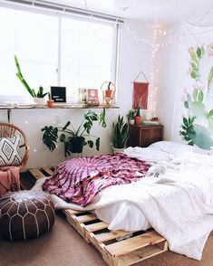 palette bed frame with boho decor