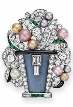 AN ART DECO DIAMOND AND MULTI-GEM BROOCH, BY MAUBOUSSIN. Designed as a floral bouquet, extending circular and single-cut diamond leaves with multi-coloured pearl buds and calibré-cut emerald and onyx detail, to the moonstone vase, mounted in platinum, circa 1925. Signed Mauboussin, France. #Mauboussin #ArtDeco #brooch