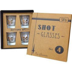 """Edgy set of 4 gold skull shot glasses packed in this rad retro inspired gift box is now available for purchase! Come in sets of 4. Each shot glass measures 2.5"""" tall."""