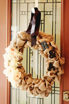Burlap wreath at a rustic wedding!  See more party ideas at CatchMyParty.com!  #partyideas #wedding