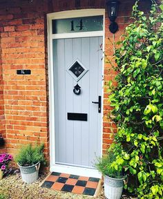 We love, love, love this Flint bullseye in fabulous French Grey. The traditional black furniture really completes the look. Solidor Door, French Grey, Black Furniture, Cottage Homes, My House, Garage Doors, Windows, Traditional, Outdoor Decor