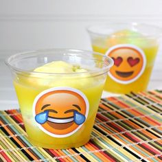 Make your Emoji Party a hit with this Emoji Pineapple Orange Sherbet Punch Recipe and Emooji Cup Decorations printable that is easy to apply.