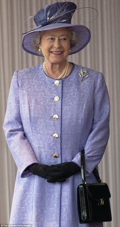 The Queen wore a black patent Royale during a state visit of the US President at Buckingham Palace in 2003
