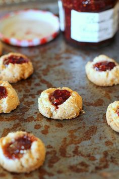 Jam Thumbprint Cookies that are gluten-free, vegan, refined sugar-free and can be made paleo. With only four ingredients, these are so easy and so delicious! From Bakerita.com