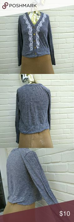 American eagle striped lacey cardigan Blue and white striped design Long sleeves Gold buttons down the middle Low V neck is cute  Brand is American eagle Size small Fits tight and flattering fit White lace down the middle near the buttons Cropped length comes to the hips New like condition, small hole on the back, pictured in the last pic #striped #blue #white #vneck #americaneagle #cardigan #sizesmall #tightfit #croppedcardigan American Eagle Outfitters Sweaters Cardigans