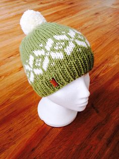 6a88749ebd1 Items similar to Fair isle beanie hat with bobble and wooden branded tag. Hand  knitted in meadow green and cream chunky yarn. on Etsy