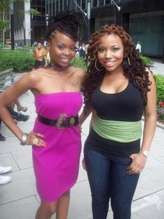 Both beautiful, but LOVE the curly locs (the colors and everythang)...