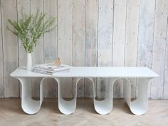 An udderly beautiful white table to store all those magazines that normally get left on the stairs! by Tim Hitchens for Design by Timber.