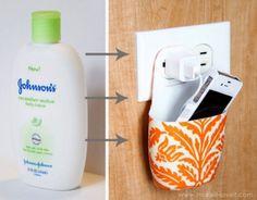 Eine Plastikflasche wird zur Handystation
