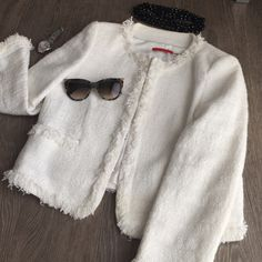 Alice and Olivia white tweed jacket like Chanel Stunning modern take on a classic Chanel brought into the world. This white tweed has soft iridescent threads throughout to give this jacket a modern update. It hits right above the wrists and has hook closures. Fits a size 4 Alice + Olivia Jackets & Coats Blazers