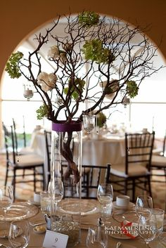 Sunset Room at Chaminade Resort, with beautiful tall flowers and branches as centerpieces. This newer trend can make your wedding reception look earthy and bring the elegance of nature fill the room. Photo by Kaemmerling Photography