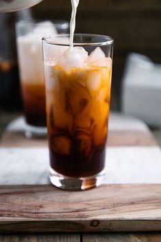 Pouring cream into glass filled with Thai Iced Tea Thai Tea Recipes, Milk Tea Recipes, Iced Tea Recipes, Coffee Recipes, Drink Recipes, Thai Food Restaurant, Thai Iced Coffee, Strawberry Pavlova, Thai Milk Tea