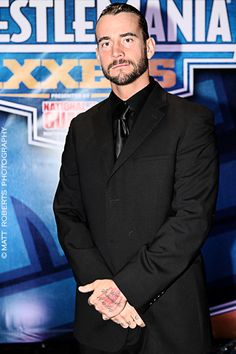 CM Punk [Hehe I met him at this Axxess signing while he was in that suit!]