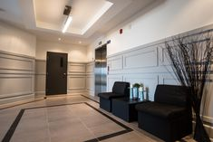 Stylish condo project lobby with secure entrance, elevator and wall elegant wall paneling #condominium