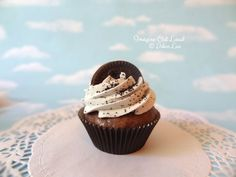FAKE cupcake, for decorative purposes. Fun table decoration that would surprise people.