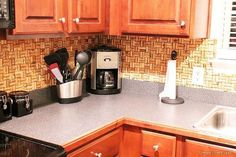 diy wine cork backsplash, home decor, kitchen backsplash, kitchen design, Use clear caulk to seal where the corks and counter come together to prevent water damage