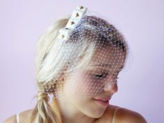 This Ivory gold studded grosgrain ribbon veil has a vintage feel to it but a modern why vibe.  Betty veil - Beyond A Veil