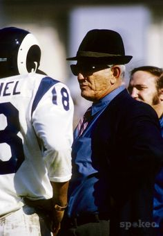 Los Angeles Rams head coach Tommy Prothro talks to Roman Gabriel (18) on the sideline during the 1971 season.